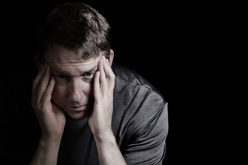 Mature man with headache from stress