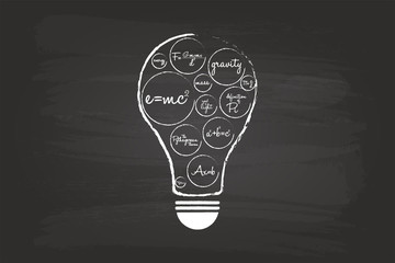 Idea Light Bulb Concept With Mathematical Equation On Blackboard