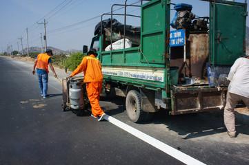 Team of traffice worker work on road