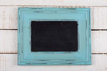 Frame on wooden background.