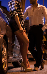 Man with prostitute next to car