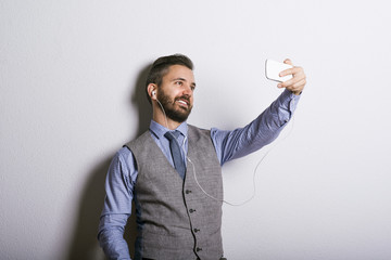 Hipster businessman with mobile phone