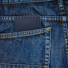 Note book in a back pocket of a jeans