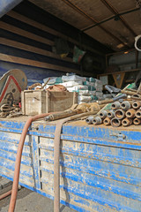 Pipes, hose and bags with cement in the truck