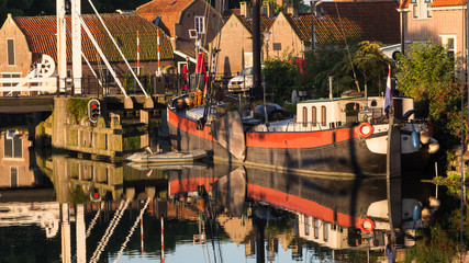 Old historic harbour of Enkhuizen Holland during sunset