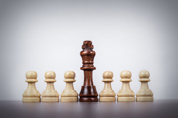 chess king leadership concept over grey background