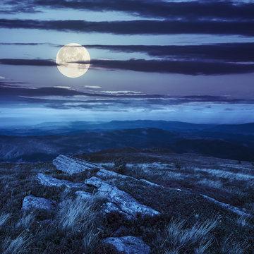 stones on the mountain top in moon light