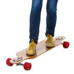 Skateboarder standing on a longboard