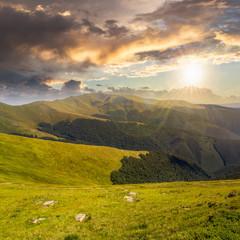 stones on the hillside of mountain range at sunset