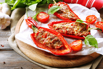Delicious stuffed peppers on table close-up