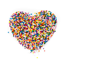 Heart shaped made from colored sprinkles
