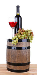 Wine in goblet and in bottle and grapes