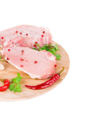 Raw meat on a wooden platter.