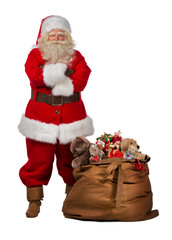 Santa Claus posing near a bag full of gifts
