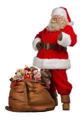 Santa Claus thumbs up near big bag full of gifts
