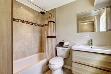 Bathroom with beige tile trim