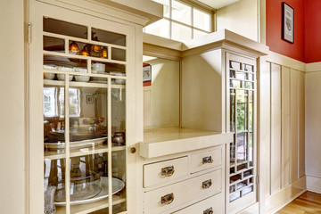 Antique storage combination with glass doors and drawers