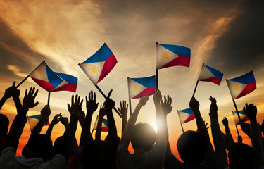 Group of People Waving Philippine Flags