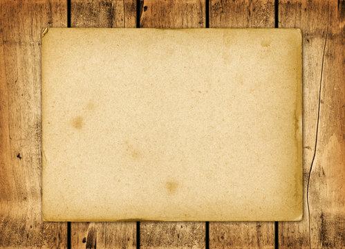 Blank vintage paper sheet on a wood board