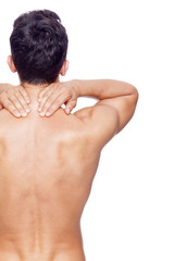 Rear view of a young man holding his back in pain, isolated on w