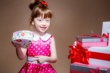 beautiful little girl with gifts