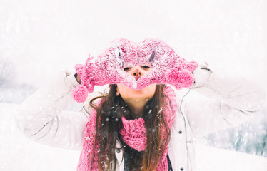 smiling young woman in winter heart