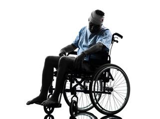 injured man in wheelchair  silhouette