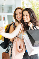 Shopping girls making a selfie