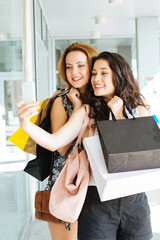 Shopping girls making a selfie