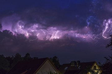 Germany, Hamburg, dramatic night sky at heavy thunderstorm
