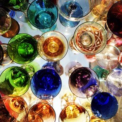 colorful old glasses on a desk of a market