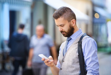 Hipster businessman with mobile