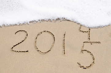 "Sign ""2014 and 2015"" on the beach"