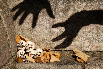 Skulls and big shadow hands trying to get them.