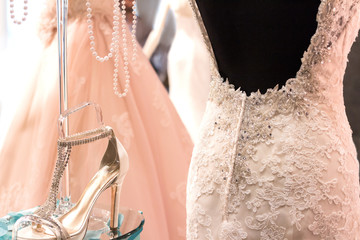 Wedding dress and shoes. Bridal shop.