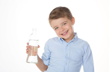 child shows a bottle