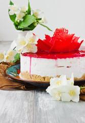 celebratory cake and jasmine flowers