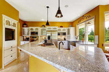 Farm house interior. Luxury kitchen room with big island and gra