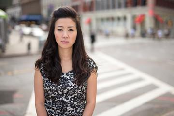 Young Asian Woman sad face portrait