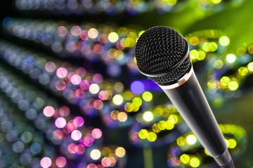 Stylish microphone on colored background