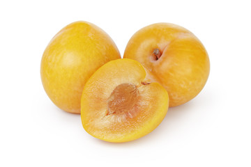 three yellow plums