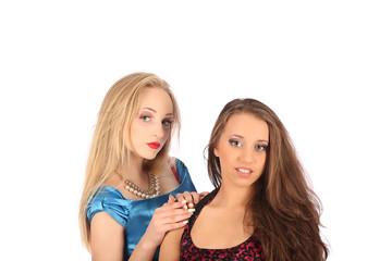portrait of two beautiful girls making selfies