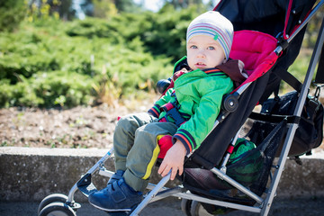 Cute Toddler in pram on a walk