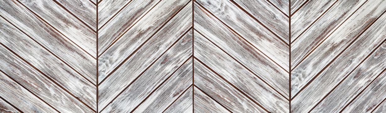 grungy bleached wooden planks in the parquet order