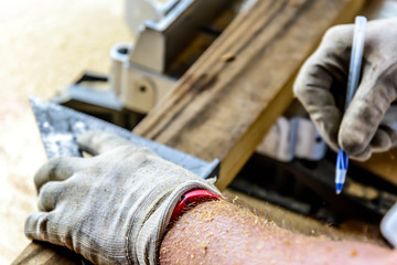man wood working table saw with hands and glove