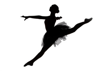 Photo of young ballerina in jump