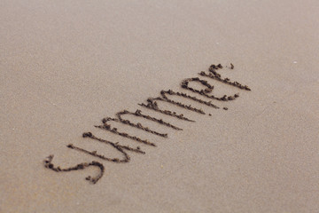 beach sand summer inscription on the sand