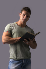 Handsome Sexy Muscular Man Reading Book