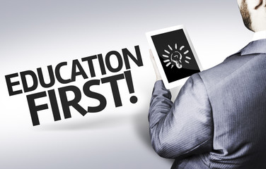 Business man with the text Education First in a concept image