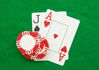 Blackjack hand on green casino table